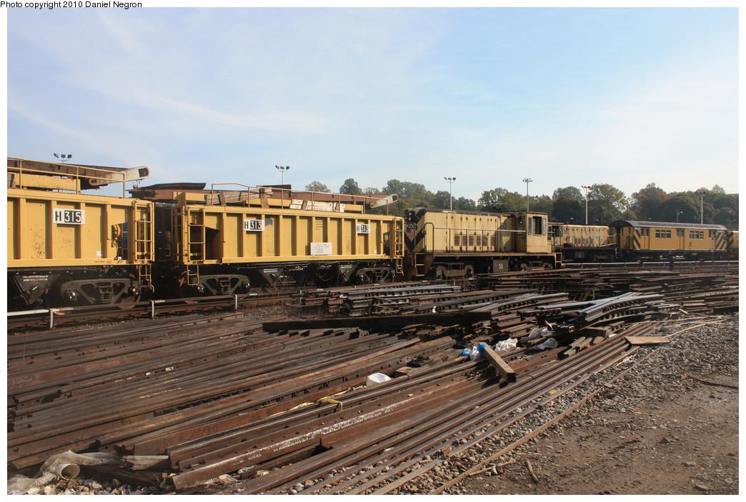 (248k, 1044x703)<br><b>Country:</b> United States<br><b>City:</b> New York<br><b>System:</b> New York City Transit<br><b>Location:</b> 36th Street Yard<br><b>Car:</b> R-116 MoW Hopper  315/313 <br><b>Photo by:</b> Daniel Negron<br><b>Date:</b> 10/20/2010<br><b>Notes:</b> With locomotive 50<br><b>Viewed (this week/total):</b> 1 / 927