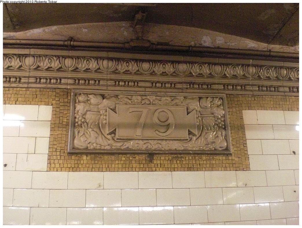(305k, 1044x788)<br><b>Country:</b> United States<br><b>City:</b> New York<br><b>System:</b> New York City Transit<br><b>Line:</b> IRT West Side Line<br><b>Location:</b> 79th Street <br><b>Photo by:</b> Roberto C. Tobar<br><b>Date:</b> 11/27/2010<br><b>Notes:</b> Station number tablet.<br><b>Viewed (this week/total):</b> 2 / 1757