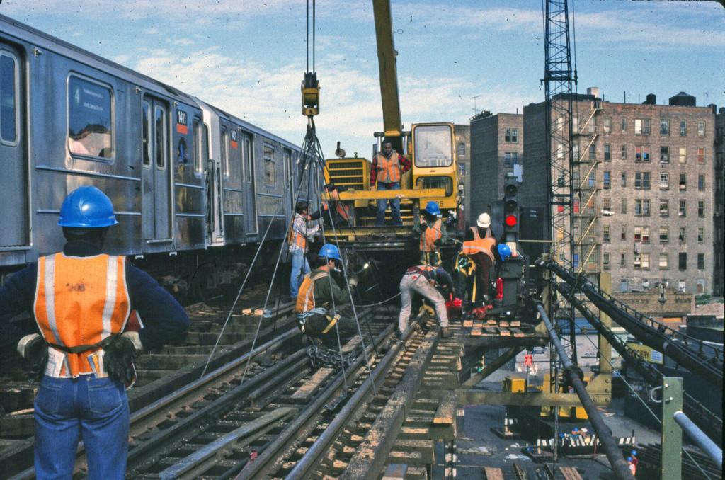 (310k, 1024x678)<br><b>Country:</b> United States<br><b>City:</b> New York<br><b>System:</b> New York City Transit<br><b>Line:</b> IRT Woodlawn Line<br><b>Location:</b> 167th Street <br><b>Route:</b> 4<br><b>Car:</b> R-62 (Kawasaki, 1983-1985)  1411 <br><b>Collection of:</b> Collection of nycsubway.org <br><b>Notes:</b> Track replacement project.<br><b>Viewed (this week/total):</b> 1 / 2036