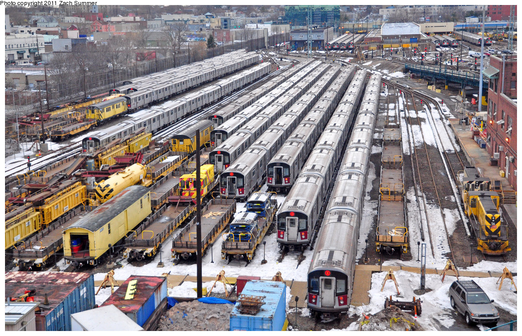 (415k, 1044x672)<br><b>Country:</b> United States<br><b>City:</b> New York<br><b>System:</b> New York City Transit<br><b>Location:</b> Westchester Yard<br><b>Photo by:</b> Zach Summer<br><b>Date:</b> 1/2/2011<br><b>Notes:</b> Visible are ballast loader/hoppers, weld car OW302, locomotives 70 & 56, and lots of R142A trainsets.<br><b>Viewed (this week/total):</b> 0 / 1825