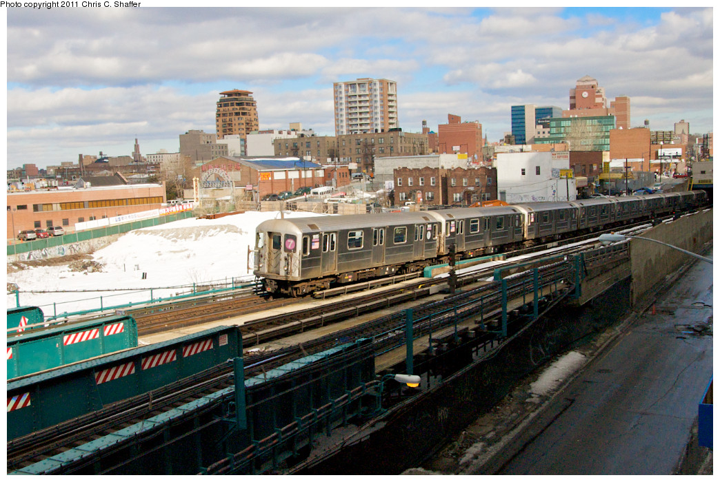 (300k, 1044x700)<br><b>Country:</b> United States<br><b>City:</b> New York<br><b>System:</b> New York City Transit<br><b>Line:</b> IRT Flushing Line<br><b>Location:</b> Main St. Tunnel Portal <br><b>Route:</b> 7<br><b>Car:</b> R-62A (Bombardier, 1984-1987)  1695 <br><b>Photo by:</b> Chris C. Shaffer<br><b>Date:</b> 2/8/2011<br><b>Notes:</b> View from Roosevelt Ave & College Point Blvd.<br><b>Viewed (this week/total):</b> 3 / 1256