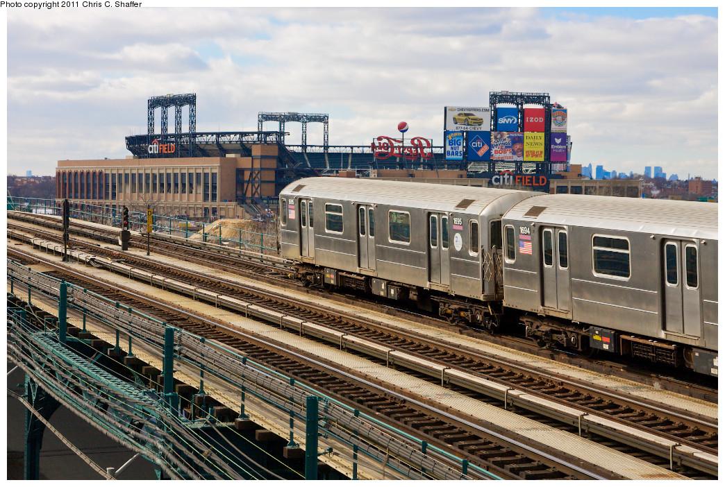 (342k, 1044x702)<br><b>Country:</b> United States<br><b>City:</b> New York<br><b>System:</b> New York City Transit<br><b>Line:</b> IRT Flushing Line<br><b>Location:</b> Main St. Tunnel Portal <br><b>Route:</b> 7<br><b>Car:</b> R-62A (Bombardier, 1984-1987)  1695 <br><b>Photo by:</b> Chris C. Shaffer<br><b>Date:</b> 2/8/2011<br><b>Notes:</b> View from Roosevelt Ave & College Point Blvd.<br><b>Viewed (this week/total):</b> 0 / 1066