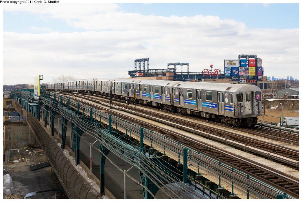 (297k, 1044x700)<br><b>Country:</b> United States<br><b>City:</b> New York<br><b>System:</b> New York City Transit<br><b>Line:</b> IRT Flushing Line<br><b>Location:</b> Main St. Tunnel Portal <br><b>Route:</b> 7<br><b>Car:</b> R-62A (Bombardier, 1984-1987)  2120 <br><b>Photo by:</b> Chris C. Shaffer<br><b>Date:</b> 2/8/2011<br><b>Notes:</b> View from Roosevelt Ave & College Point Blvd.<br><b>Viewed (this week/total):</b> 2 / 940