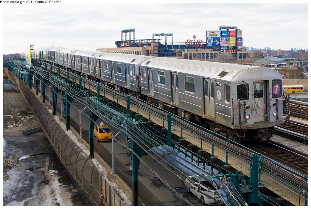(314k, 1044x703)<br><b>Country:</b> United States<br><b>City:</b> New York<br><b>System:</b> New York City Transit<br><b>Line:</b> IRT Flushing Line<br><b>Location:</b> Main St. Tunnel Portal <br><b>Route:</b> 7<br><b>Car:</b> R-62A (Bombardier, 1984-1987)  2154 <br><b>Photo by:</b> Chris C. Shaffer<br><b>Date:</b> 2/8/2011<br><b>Notes:</b> View from Roosevelt Ave & College Point Blvd.<br><b>Viewed (this week/total):</b> 1 / 1284