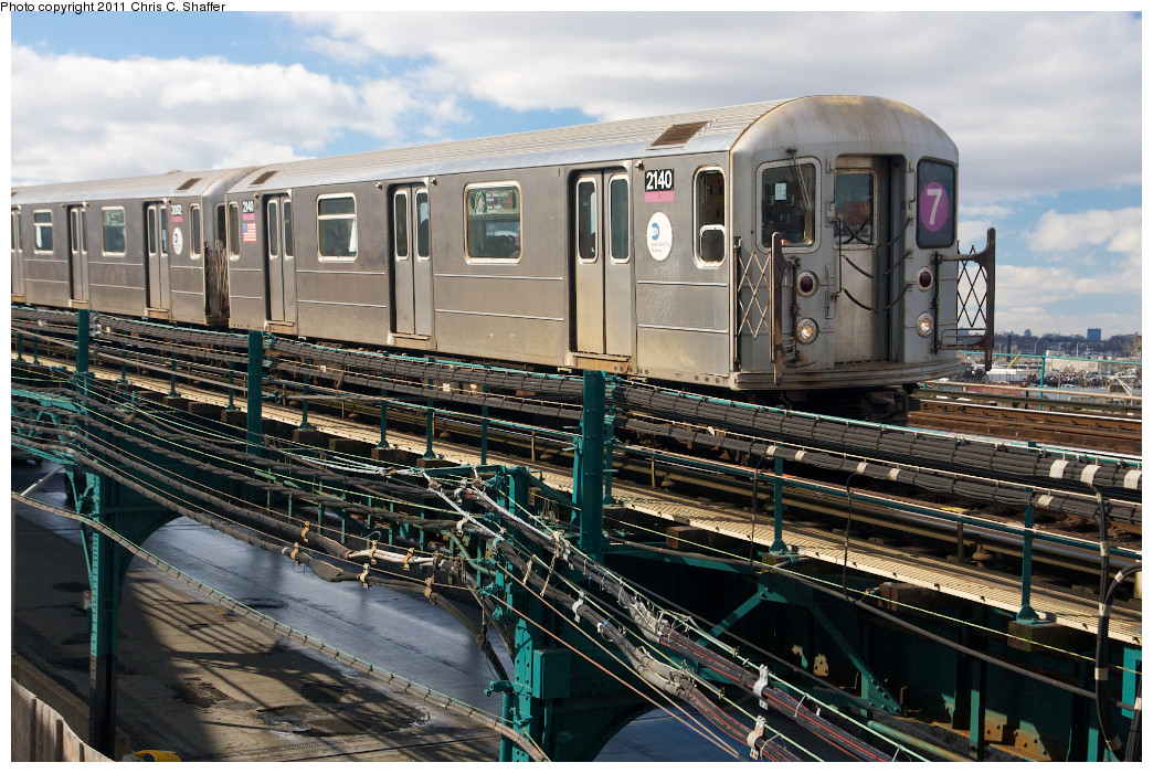 (311k, 1044x700)<br><b>Country:</b> United States<br><b>City:</b> New York<br><b>System:</b> New York City Transit<br><b>Line:</b> IRT Flushing Line<br><b>Location:</b> Main St. Tunnel Portal <br><b>Route:</b> 7<br><b>Car:</b> R-62A (Bombardier, 1984-1987)  2140 <br><b>Photo by:</b> Chris C. Shaffer<br><b>Date:</b> 2/8/2011<br><b>Notes:</b> View from Roosevelt Ave & College Point Blvd.<br><b>Viewed (this week/total):</b> 1 / 1213