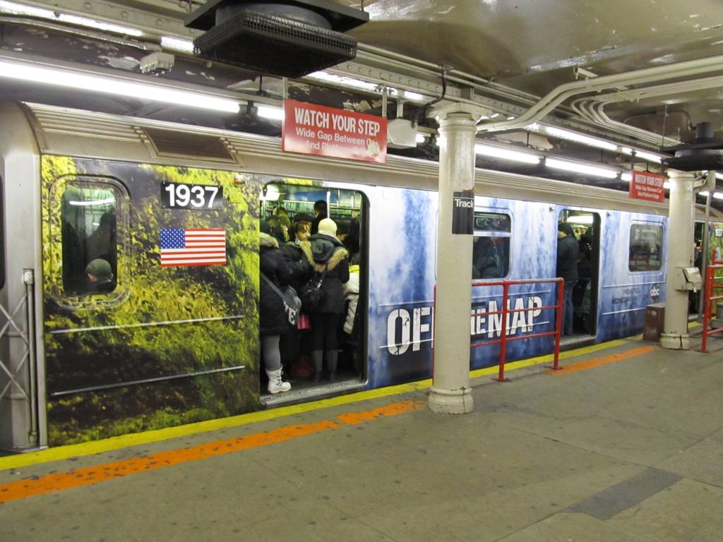 (127k, 1024x768)<br><b>Country:</b> United States<br><b>City:</b> New York<br><b>System:</b> New York City Transit<br><b>Line:</b> IRT Times Square-Grand Central Shuttle<br><b>Location:</b> Times Square <br><b>Route:</b> S<br><b>Car:</b> R-62A (Bombardier, 1984-1987)  1937 <br><b>Photo by:</b> Robbie Rosenfeld<br><b>Date:</b> 1/13/2011<br><b>Notes:</b> Off the Map TV show decals.<br><b>Viewed (this week/total):</b> 6 / 1373