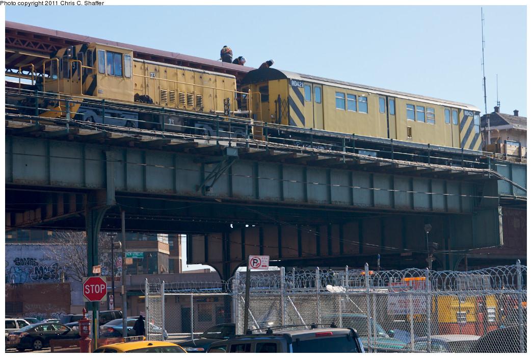 (281k, 1044x702)<br><b>Country:</b> United States<br><b>City:</b> New York<br><b>System:</b> New York City Transit<br><b>Line:</b> BMT West End Line<br><b>Location:</b> 62nd Street <br><b>Route:</b> Work Service<br><b>Car:</b> R-52 Locomotive  73 <br><b>Photo by:</b> Chris C. Shaffer<br><b>Date:</b> 2/11/2011<br><b>Notes:</b> With R-161 Rider Car (ex-R-33) RD421 (ex-9032)<br><b>Viewed (this week/total):</b> 0 / 881