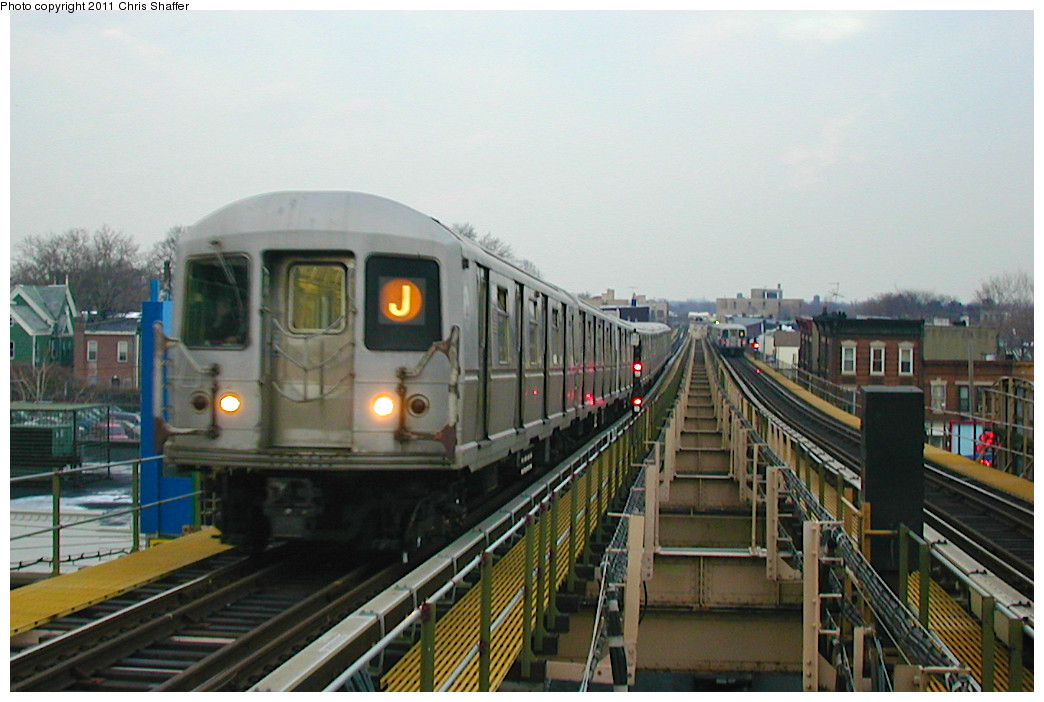 (226k, 1044x702)<br><b>Country:</b> United States<br><b>City:</b> New York<br><b>System:</b> New York City Transit<br><b>Line:</b> BMT Nassau Street/Jamaica Line<br><b>Location:</b> Alabama Avenue <br><b>Route:</b> J<br><b>Car:</b> R-40M (St. Louis, 1969)   <br><b>Photo by:</b> Chris C. Shaffer<br><b>Date:</b> 12/8/2002<br><b>Viewed (this week/total):</b> 2 / 1694