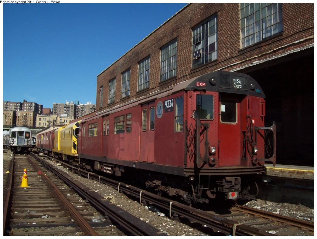 (255k, 1044x788)<br><b>Country:</b> United States<br><b>City:</b> New York<br><b>System:</b> New York City Transit<br><b>Location:</b> 207th Street Yard<br><b>Route:</b> Work Service<br><b>Car:</b> R-33 World's Fair (St. Louis, 1963-64) 9334 <br><b>Photo by:</b> Glenn L. Rowe<br><b>Date:</b> 3/8/2011<br><b>Notes:</b> Signal dolly train.<br><b>Viewed (this week/total):</b> 0 / 1436