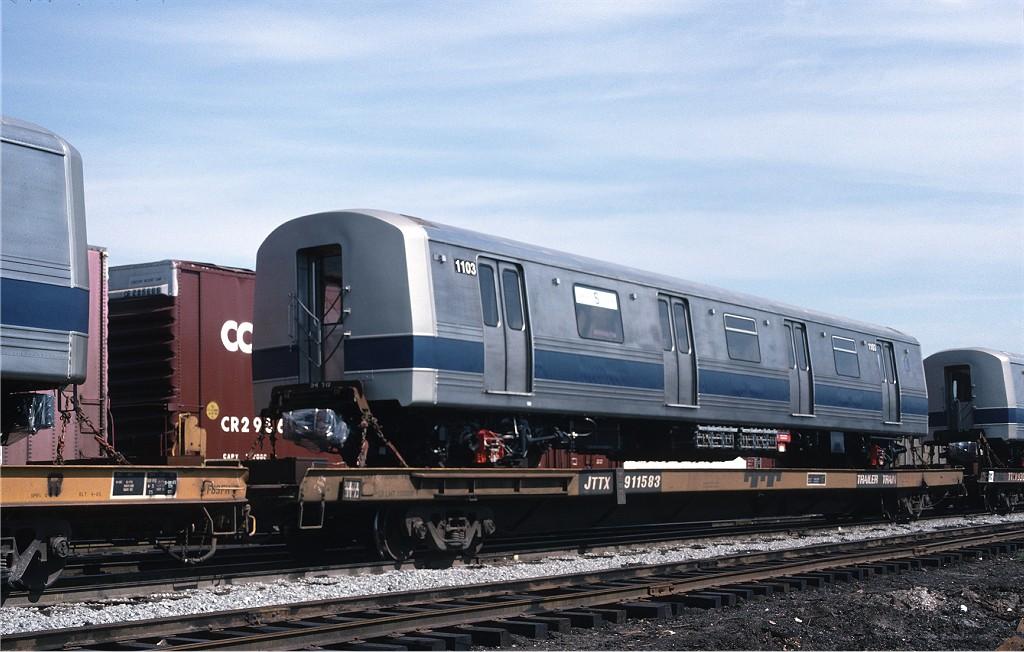 (178k, 1024x652)<br><b>Country:</b> United States<br><b>City:</b> Secaucus, NJ<br><b>System:</b> New York City Transit<br><b>Location:</b> Croxton Yard (NYCTA Equipment Delivery)<br><b>Car:</b> R-46 (Pullman-Standard, 1974-75) 1103 <br><b>Collection of:</b> Joe Testagrose<br><b>Date:</b> 7/24/1977<br><b>Notes:</b> Flat Car JTTX911583<br><b>Viewed (this week/total):</b> 0 / 649