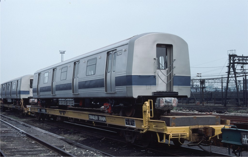 (135k, 1024x651)<br><b>Country:</b> United States<br><b>City:</b> Hoboken, NJ<br><b>System:</b> New York City Transit<br><b>Location:</b> Hoboken Yard <br><b>Car:</b> R-46 (Pullman-Standard, 1974-75) 1033 <br><b>Photo by:</b> Ed McKernan<br><b>Collection of:</b> Joe Testagrose<br><b>Date:</b> 5/21/1977<br><b>Notes:</b> Flat Car JTTX913533<br><b>Viewed (this week/total):</b> 1 / 501