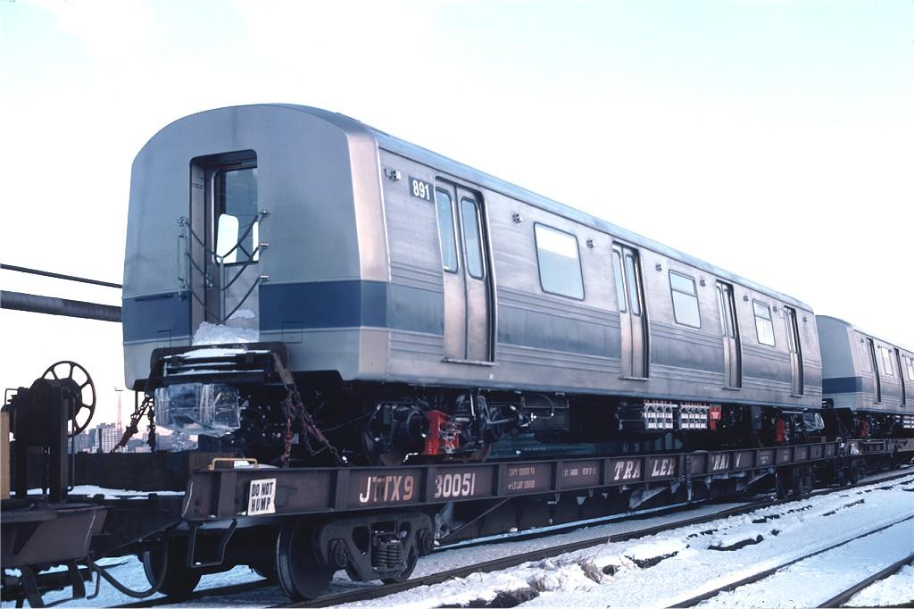 (149k, 1024x682)<br><b>Country:</b> United States<br><b>City:</b> Hoboken, NJ<br><b>System:</b> New York City Transit<br><b>Location:</b> Hoboken Yard <br><b>Car:</b> R-46 (Pullman-Standard, 1974-75) 891 <br><b>Collection of:</b> Joe Testagrose<br><b>Date:</b> 12/27/1976<br><b>Notes:</b> Flat Car JTTX930051<br><b>Viewed (this week/total):</b> 0 / 582