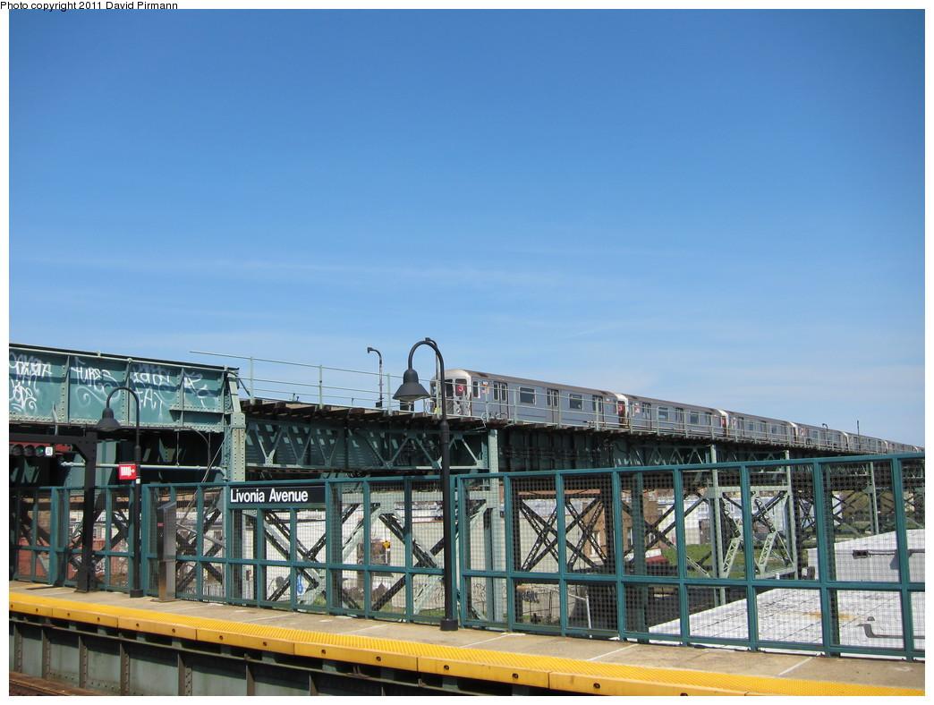 (205k, 1044x788)<br><b>Country:</b> United States<br><b>City:</b> New York<br><b>System:</b> New York City Transit<br><b>Line:</b> BMT Canarsie Line<br><b>Location:</b> Livonia Avenue <br><b>Route:</b> 3<br><b>Car:</b> R-62 (Kawasaki, 1983-1985)  1401 <br><b>Photo by:</b> David Pirmann<br><b>Date:</b> 4/9/2011<br><b>Notes:</b> View of IRT from Canarsie line platform.<br><b>Viewed (this week/total):</b> 0 / 1031
