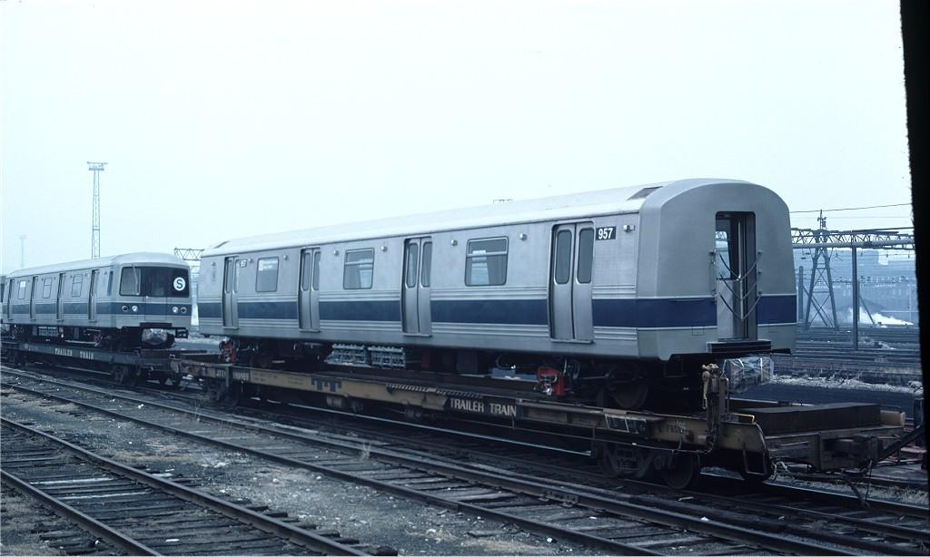(139k, 1024x614)<br><b>Country:</b> United States<br><b>City:</b> Hoboken, NJ<br><b>System:</b> New York City Transit<br><b>Location:</b> Hoboken Yard <br><b>Car:</b> R-46 (Pullman-Standard, 1974-75) 957 <br><b>Collection of:</b> Joe Testagrose<br><b>Date:</b> 3/12/1977<br><b>Notes:</b> Flat JTTX910969<br><b>Viewed (this week/total):</b> 0 / 497