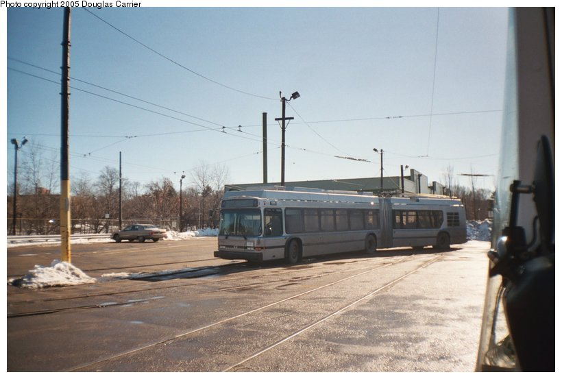 (97k, 820x553)<br><b>Country:</b> United States<br><b>City:</b> Boston, MA<br><b>System:</b> MBTA Boston<br><b>Line:</b> MBTA Silver Line (Phase II)<br><b>Location:</b> Watertown Yard<br><b>Car:</b> MBTA Dual Mode (Electric/Diesel) 1111 <br><b>Photo by:</b> Douglas Carrier<br><b>Date:</b> 2/2005<br><b>Notes:</b> DMA 1111 at Watertown Yard for testing Feb. 2005<br><b>Viewed (this week/total):</b> 2 / 3715