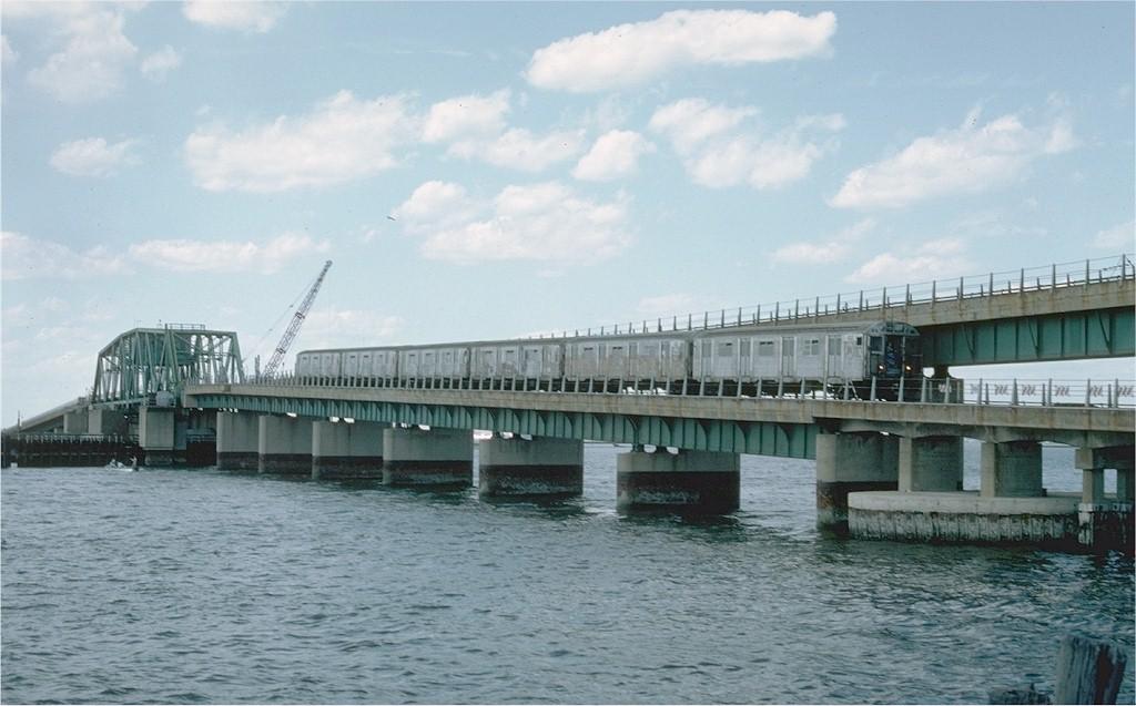 (159k, 1024x637)<br><b>Country:</b> United States<br><b>City:</b> New York<br><b>System:</b> New York City Transit<br><b>Line:</b> IND Rockaway<br><b>Location:</b> South Channel Bridge <br><b>Car:</b> R-32 (Budd, 1964)  3434 <br><b>Photo by:</b> Ed McKernan<br><b>Collection of:</b> Joe Testagrose<br><b>Date:</b> 6/19/1977<br><b>Viewed (this week/total):</b> 0 / 4009