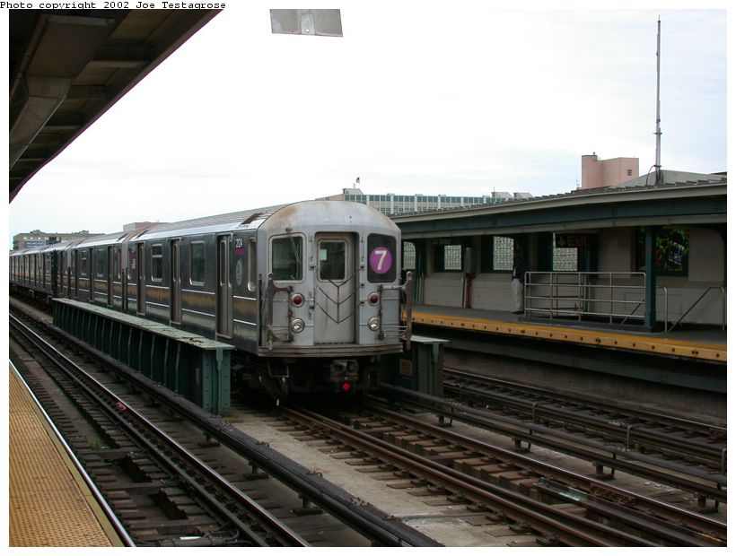 (113k, 820x620)<br><b>Country:</b> United States<br><b>City:</b> New York<br><b>System:</b> New York City Transit<br><b>Line:</b> IRT Flushing Line<br><b>Location:</b> 33rd Street/Rawson Street <br><b>Route:</b> 7<br><b>Car:</b> R-62A (Bombardier, 1984-1987)  2124 <br><b>Photo by:</b> Joe Testagrose<br><b>Date:</b> 6/4/2002<br><b>Viewed (this week/total):</b> 0 / 2868