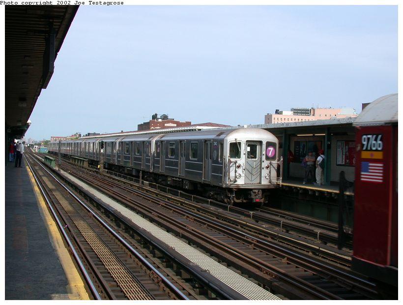 (116k, 820x620)<br><b>Country:</b> United States<br><b>City:</b> New York<br><b>System:</b> New York City Transit<br><b>Line:</b> IRT Flushing Line<br><b>Location:</b> 74th Street/Broadway <br><b>Route:</b> 7<br><b>Car:</b> R-62A (Bombardier, 1984-1987)  2142 <br><b>Photo by:</b> Joe Testagrose<br><b>Date:</b> 6/4/2002<br><b>Viewed (this week/total):</b> 0 / 3189