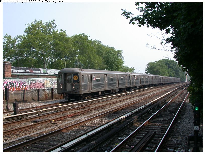 (156k, 820x620)<br><b>Country:</b> United States<br><b>City:</b> New York<br><b>System:</b> New York City Transit<br><b>Line:</b> BMT Brighton Line<br><b>Location:</b> Avenue J <br><b>Route:</b> Q<br><b>Car:</b> R-68 (Westinghouse-Amrail, 1986-1988)  2854 <br><b>Photo by:</b> Joe Testagrose<br><b>Date:</b> 6/11/2002<br><b>Viewed (this week/total):</b> 3 / 3854