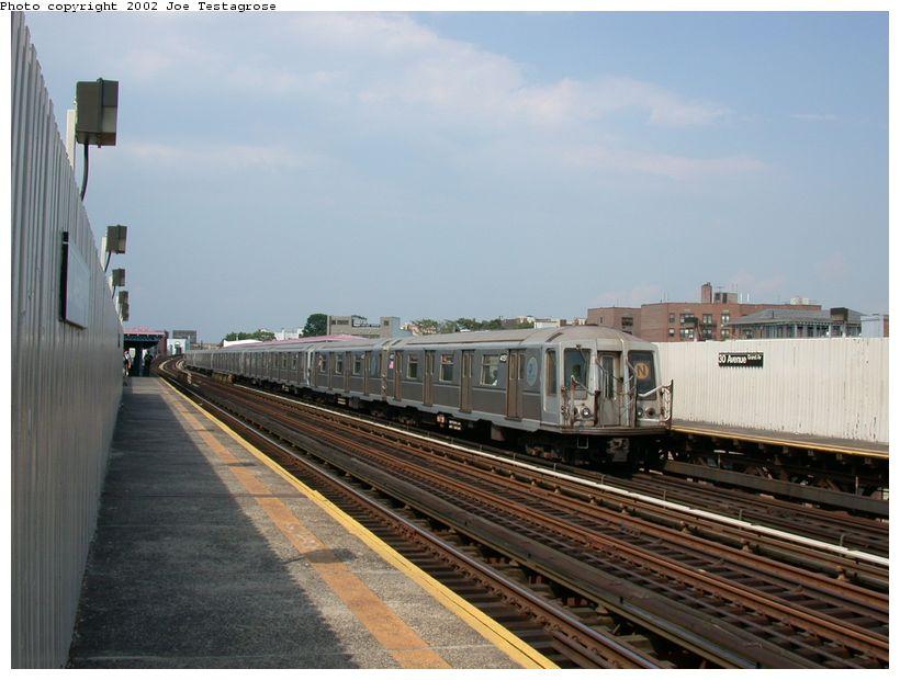 (109k, 820x620)<br><b>Country:</b> United States<br><b>City:</b> New York<br><b>System:</b> New York City Transit<br><b>Line:</b> BMT Astoria Line<br><b>Location:</b> 30th/Grand Aves. <br><b>Route:</b> Q<br><b>Car:</b> R-40 (St. Louis, 1968)  4151 <br><b>Photo by:</b> Joe Testagrose<br><b>Date:</b> 6/19/2002<br><b>Viewed (this week/total):</b> 1 / 5428