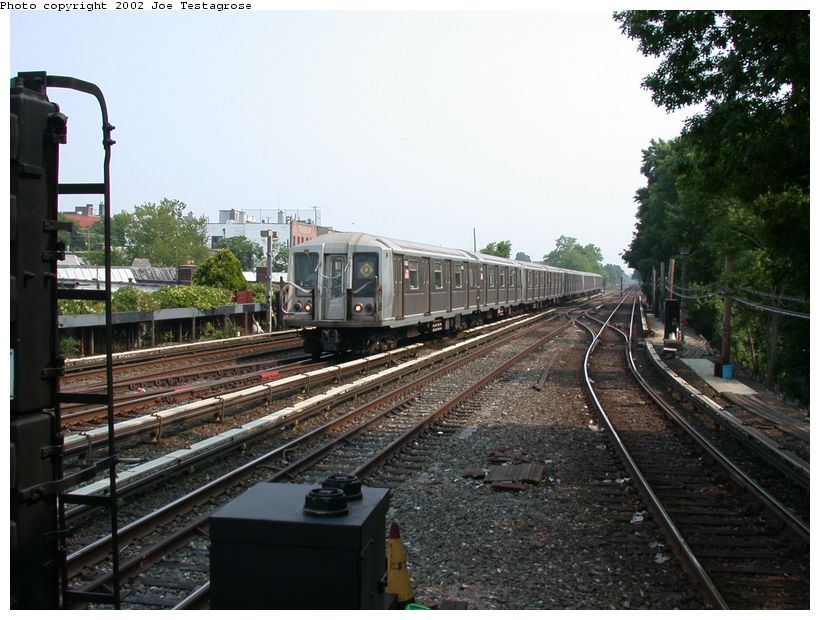 (133k, 820x620)<br><b>Country:</b> United States<br><b>City:</b> New York<br><b>System:</b> New York City Transit<br><b>Line:</b> BMT Brighton Line<br><b>Location:</b> Kings Highway <br><b>Route:</b> Q<br><b>Car:</b> R-40 (St. Louis, 1968)  4164 <br><b>Photo by:</b> Joe Testagrose<br><b>Date:</b> 6/11/2002<br><b>Viewed (this week/total):</b> 1 / 3195
