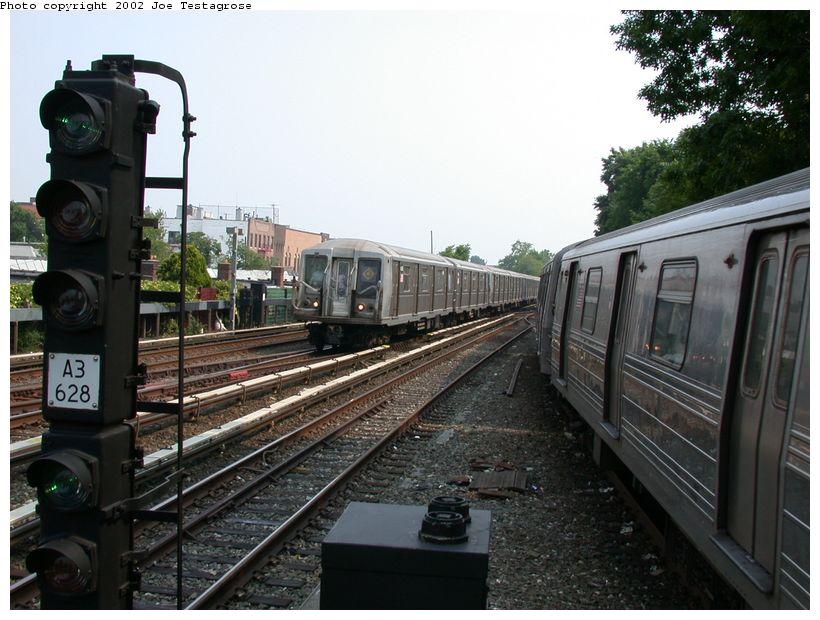 (128k, 820x620)<br><b>Country:</b> United States<br><b>City:</b> New York<br><b>System:</b> New York City Transit<br><b>Line:</b> BMT Brighton Line<br><b>Location:</b> Kings Highway <br><b>Route:</b> Q<br><b>Car:</b> R-40 (St. Louis, 1968)  4168 <br><b>Photo by:</b> Joe Testagrose<br><b>Date:</b> 6/11/2002<br><b>Viewed (this week/total):</b> 0 / 3713