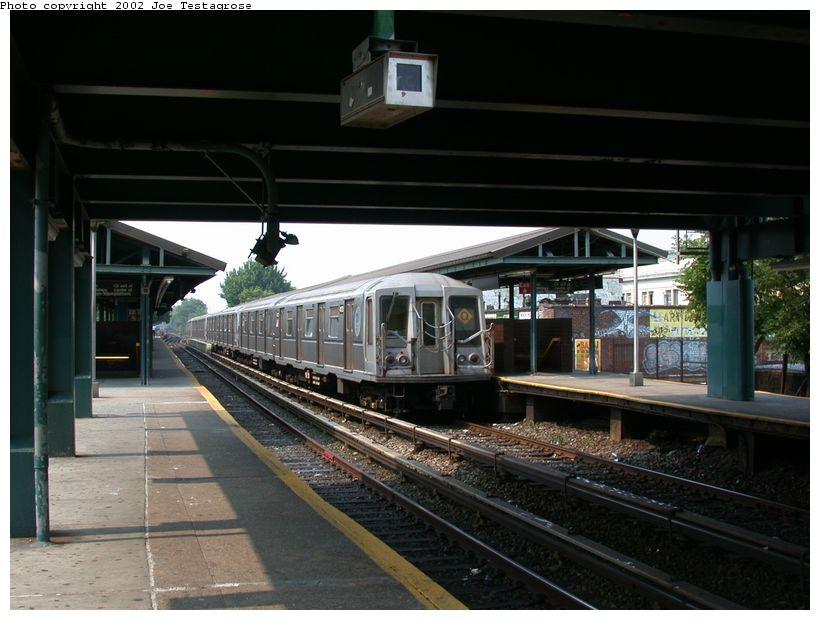 (115k, 820x620)<br><b>Country:</b> United States<br><b>City:</b> New York<br><b>System:</b> New York City Transit<br><b>Line:</b> BMT Brighton Line<br><b>Location:</b> Kings Highway <br><b>Route:</b> Q<br><b>Car:</b> R-40 (St. Louis, 1968)  4173 <br><b>Photo by:</b> Joe Testagrose<br><b>Date:</b> 6/11/2002<br><b>Viewed (this week/total):</b> 1 / 3837