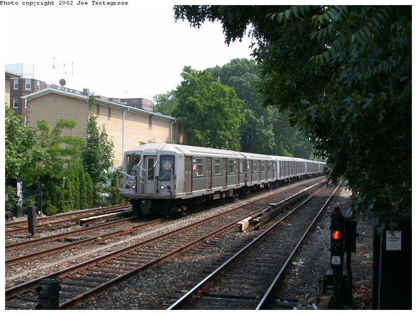(152k, 820x620)<br><b>Country:</b> United States<br><b>City:</b> New York<br><b>System:</b> New York City Transit<br><b>Line:</b> BMT Brighton Line<br><b>Location:</b> Avenue H <br><b>Route:</b> Q<br><b>Car:</b> R-40 (St. Louis, 1968)  4214 <br><b>Photo by:</b> Joe Testagrose<br><b>Date:</b> 6/11/2002<br><b>Viewed (this week/total):</b> 0 / 4304