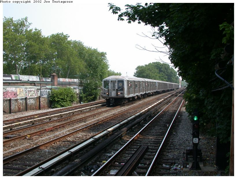 (151k, 820x620)<br><b>Country:</b> United States<br><b>City:</b> New York<br><b>System:</b> New York City Transit<br><b>Line:</b> BMT Brighton Line<br><b>Location:</b> Avenue J <br><b>Route:</b> Q<br><b>Car:</b> R-40 (St. Louis, 1968)  4241 <br><b>Photo by:</b> Joe Testagrose<br><b>Date:</b> 6/11/2002<br><b>Viewed (this week/total):</b> 3 / 3927