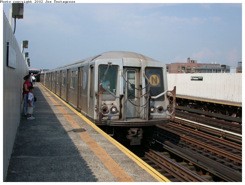 (117k, 820x620)<br><b>Country:</b> United States<br><b>City:</b> New York<br><b>System:</b> New York City Transit<br><b>Line:</b> BMT Astoria Line<br><b>Location:</b> 30th/Grand Aves. <br><b>Route:</b> N<br><b>Car:</b> R-40 (St. Louis, 1968)  4277 <br><b>Photo by:</b> Joe Testagrose<br><b>Date:</b> 6/19/2002<br><b>Viewed (this week/total):</b> 1 / 3790