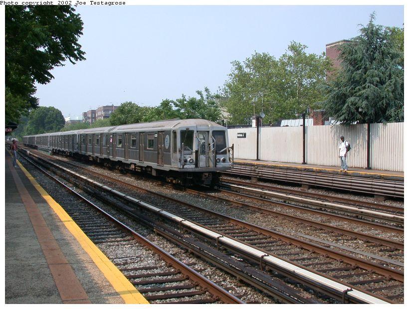 (154k, 820x620)<br><b>Country:</b> United States<br><b>City:</b> New York<br><b>System:</b> New York City Transit<br><b>Line:</b> BMT Brighton Line<br><b>Location:</b> Avenue J <br><b>Route:</b> Q<br><b>Car:</b> R-40 (St. Louis, 1968)  4328 <br><b>Photo by:</b> Joe Testagrose<br><b>Date:</b> 6/11/2002<br><b>Viewed (this week/total):</b> 0 / 2710
