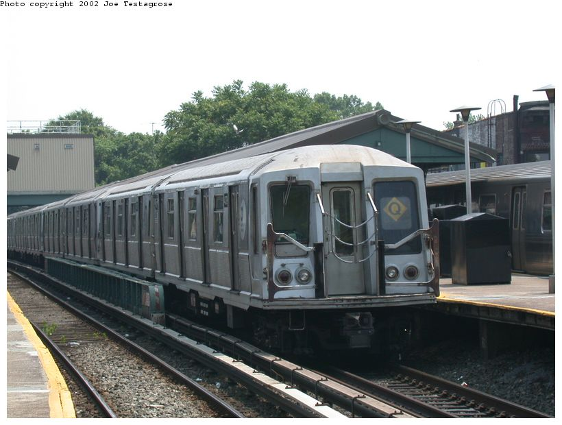 (116k, 820x620)<br><b>Country:</b> United States<br><b>City:</b> New York<br><b>System:</b> New York City Transit<br><b>Line:</b> BMT Brighton Line<br><b>Location:</b> Kings Highway <br><b>Route:</b> Q<br><b>Car:</b> R-40 (St. Louis, 1968)  4379 <br><b>Photo by:</b> Joe Testagrose<br><b>Date:</b> 6/11/2002<br><b>Viewed (this week/total):</b> 0 / 3532