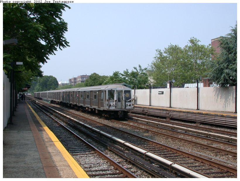(143k, 820x620)<br><b>Country:</b> United States<br><b>City:</b> New York<br><b>System:</b> New York City Transit<br><b>Line:</b> BMT Brighton Line<br><b>Location:</b> Avenue J <br><b>Route:</b> Q<br><b>Car:</b> R-40 (St. Louis, 1968)  4385 <br><b>Photo by:</b> Joe Testagrose<br><b>Date:</b> 6/11/2002<br><b>Viewed (this week/total):</b> 0 / 3359