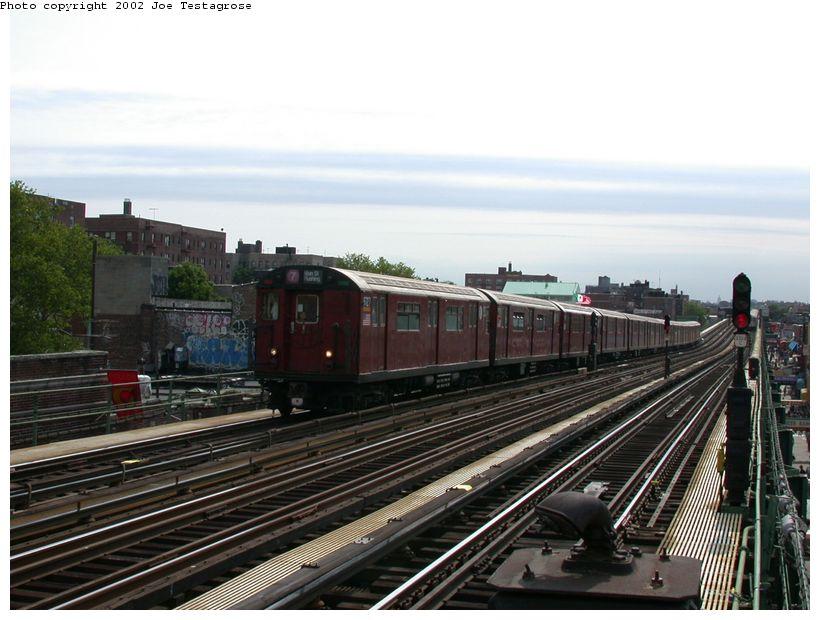 (119k, 820x620)<br><b>Country:</b> United States<br><b>City:</b> New York<br><b>System:</b> New York City Transit<br><b>Line:</b> IRT Flushing Line<br><b>Location:</b> 82nd Street/Jackson Heights <br><b>Route:</b> 7<br><b>Car:</b> R-36 World's Fair (St. Louis, 1963-64) 9727 <br><b>Photo by:</b> Joe Testagrose<br><b>Date:</b> 6/4/2002<br><b>Viewed (this week/total):</b> 0 / 2469