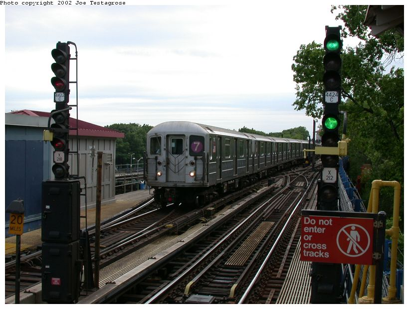 (128k, 820x620)<br><b>Country:</b> United States<br><b>City:</b> New York<br><b>System:</b> New York City Transit<br><b>Line:</b> IRT Flushing Line<br><b>Location:</b> Willets Point/Mets (fmr. Shea Stadium) <br><b>Route:</b> 7<br><b>Car:</b> R-62A (Bombardier, 1984-1987)  1715 <br><b>Photo by:</b> Joe Testagrose<br><b>Date:</b> 6/4/2002<br><b>Viewed (this week/total):</b> 1 / 3222