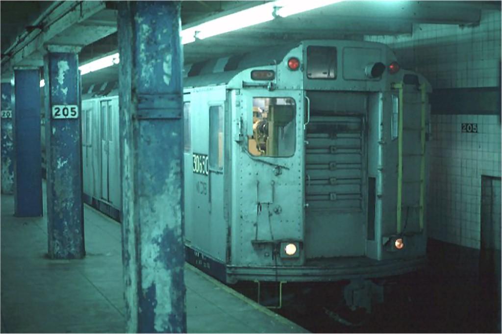 (121k, 1024x681)<br><b>Country:</b> United States<br><b>City:</b> New York<br><b>System:</b> New York City Transit<br><b>Line:</b> IND Concourse Line<br><b>Location:</b> 205th Street <br><b>Car:</b> Station Wash Train (R-12 Rebuilds)  30630 (ex-5709)<br><b>Photo by:</b> Steve Zabel<br><b>Collection of:</b> Joe Testagrose<br><b>Date:</b> 4/10/1975<br><b>Viewed (this week/total):</b> 3 / 11652