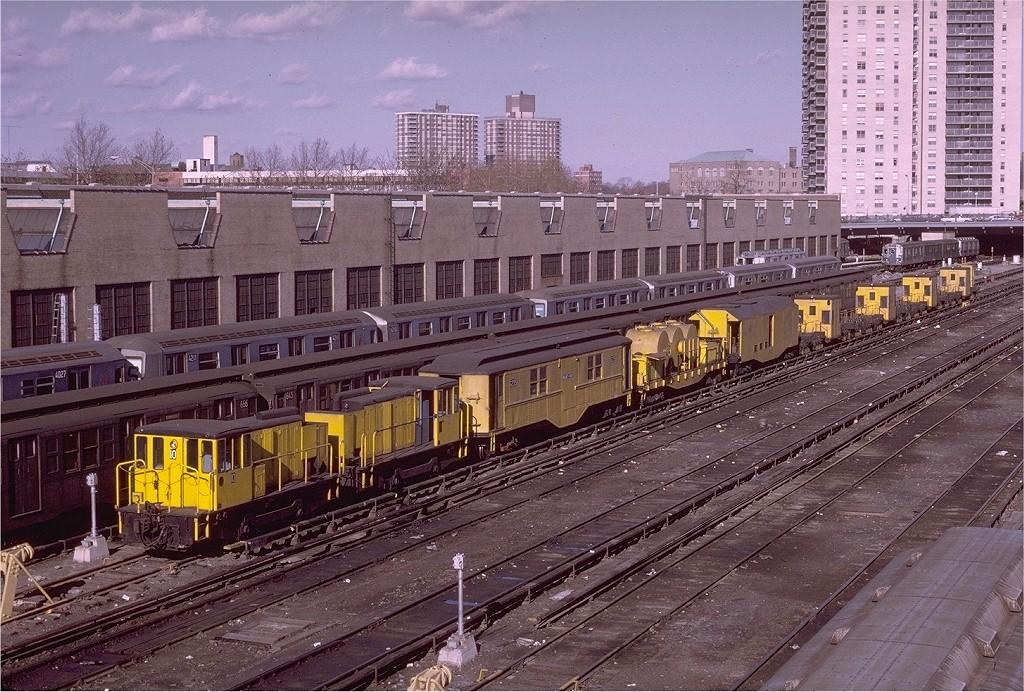(274k, 1024x692)<br><b>Country:</b> United States<br><b>City:</b> New York<br><b>System:</b> New York City Transit<br><b>Location:</b> Concourse Yard<br><b>Car:</b> Speno Rail Grinder  <br><b>Photo by:</b> Joe Testagrose<br><b>Date:</b> 11/21/1970<br><b>Notes:</b> Visible are the two GE 70 locomotives 10 & 11, blower and fan car G236 (ex Low-V 4954), F111 sprayer car, F122 generator box car, and the four Speno rail grinders G231-G234.<br><b>Viewed (this week/total):</b> 4 / 4895