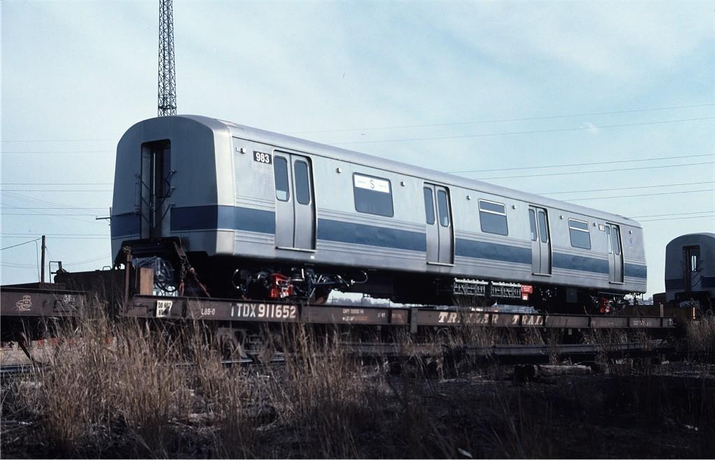 (160k, 1024x659)<br><b>Country:</b> United States<br><b>City:</b> Secaucus, NJ<br><b>System:</b> New York City Transit<br><b>Location:</b> Croxton Yard (NYCTA Equipment Delivery)<br><b>Car:</b> R-46 (Pullman-Standard, 1974-75) 983 <br><b>Photo by:</b> Ed McKernan<br><b>Collection of:</b> Joe Testagrose<br><b>Date:</b> 4/1977<br><b>Viewed (this week/total):</b> 0 / 539