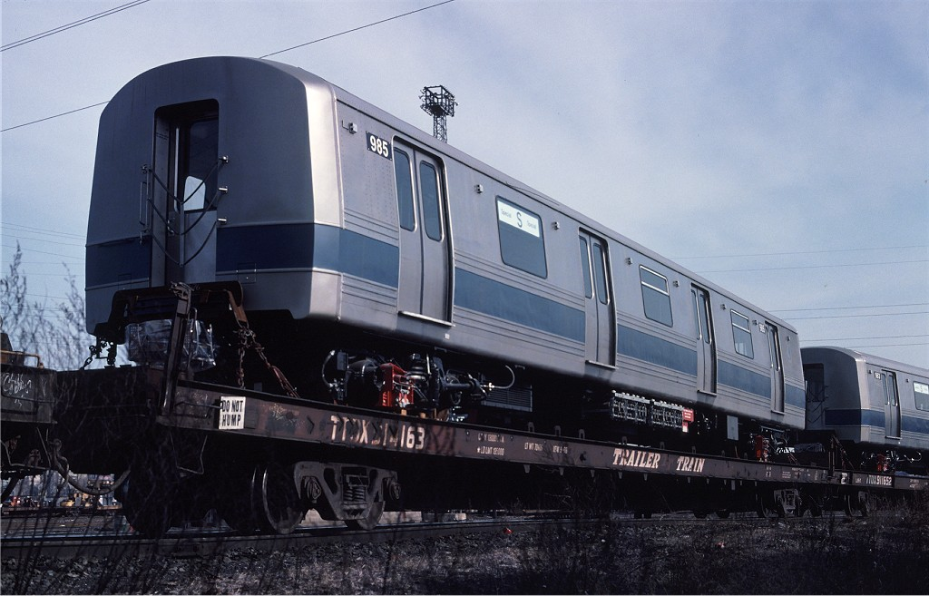 (165k, 1024x657)<br><b>Country:</b> United States<br><b>City:</b> Secaucus, NJ<br><b>System:</b> New York City Transit<br><b>Location:</b> Croxton Yard (NYCTA Equipment Delivery)<br><b>Car:</b> R-46 (Pullman-Standard, 1974-75) 985 <br><b>Photo by:</b> Ed McKernan<br><b>Collection of:</b> Joe Testagrose<br><b>Date:</b> 3/29/1977<br><b>Viewed (this week/total):</b> 3 / 443