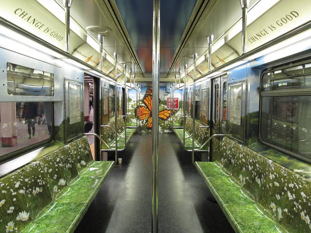 (141k, 1024x768)<br><b>Country:</b> United States<br><b>City:</b> New York<br><b>System:</b> New York City Transit<br><b>Route:</b> S<br><b>Car:</b> R-62A (Bombardier, 1984-1987)  1931 <br><b>Photo by:</b> Robbie Rosenfeld<br><b>Date:</b> 3/29/2011<br><b>Notes:</b> Adelphi U. wrap.<br><b>Viewed (this week/total):</b> 0 / 824