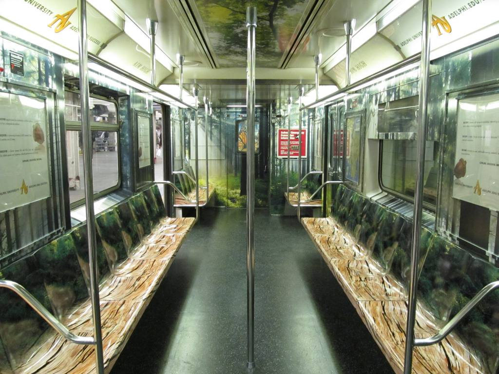 (143k, 1024x768)<br><b>Country:</b> United States<br><b>City:</b> New York<br><b>System:</b> New York City Transit<br><b>Route:</b> S<br><b>Car:</b> R-62A (Bombardier, 1984-1987)  1937 <br><b>Photo by:</b> Robbie Rosenfeld<br><b>Date:</b> 3/29/2011<br><b>Notes:</b> Adelphi U. wrap.<br><b>Viewed (this week/total):</b> 0 / 609