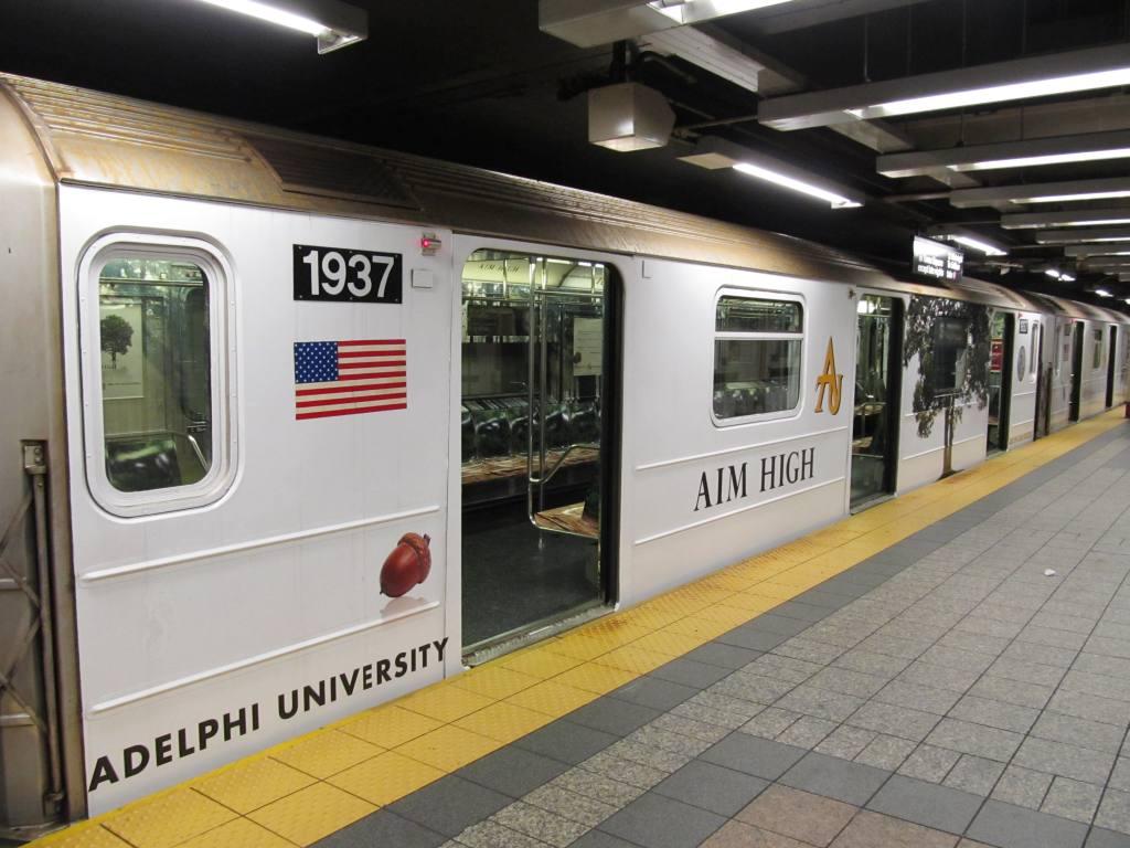 (112k, 1024x768)<br><b>Country:</b> United States<br><b>City:</b> New York<br><b>System:</b> New York City Transit<br><b>Line:</b> IRT Times Square-Grand Central Shuttle<br><b>Location:</b> Grand Central <br><b>Route:</b> S<br><b>Car:</b> R-62A (Bombardier, 1984-1987)  1937 <br><b>Photo by:</b> Robbie Rosenfeld<br><b>Date:</b> 3/30/2011<br><b>Notes:</b> Adelphi U. wrap.<br><b>Viewed (this week/total):</b> 0 / 666