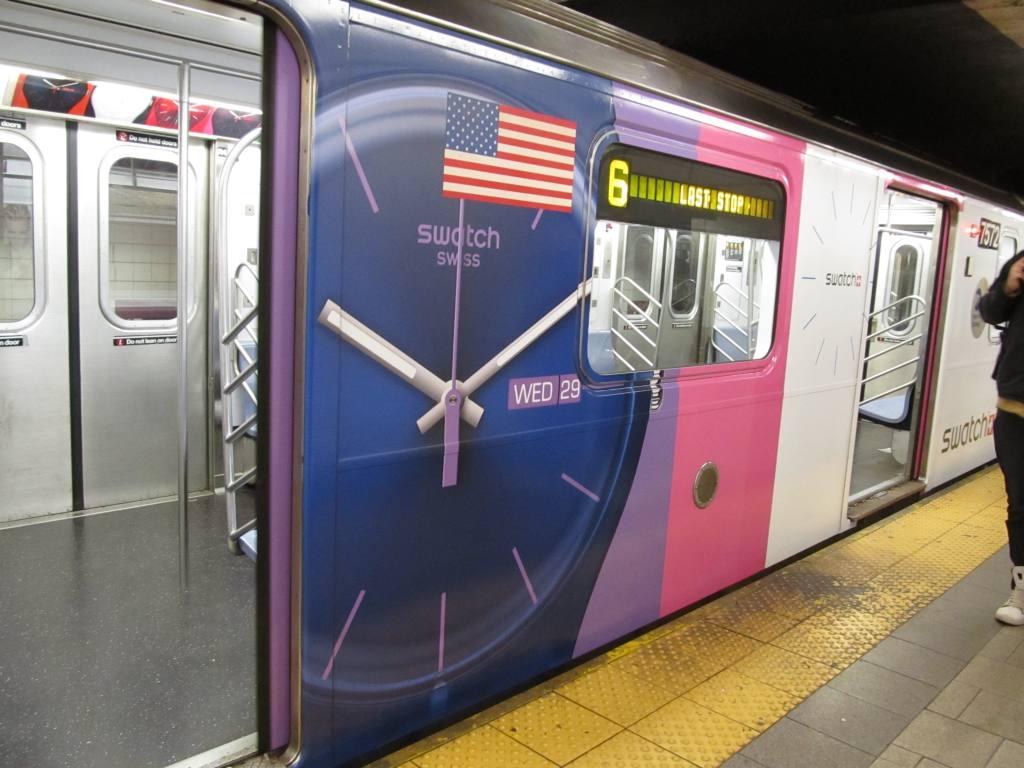 (105k, 1024x768)<br><b>Country:</b> United States<br><b>City:</b> New York<br><b>System:</b> New York City Transit<br><b>Line:</b> IRT East Side Line<br><b>Location:</b> Grand Central <br><b>Route:</b> 6<br><b>Car:</b> R-142A (Primary Order, Kawasaki, 1999-2002)  7572 <br><b>Photo by:</b> Robbie Rosenfeld<br><b>Date:</b> 4/6/2011<br><b>Notes:</b> Swatch ad wrap.<br><b>Viewed (this week/total):</b> 0 / 1424