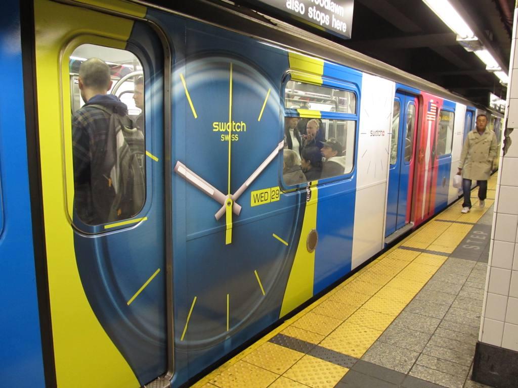 (112k, 1024x768)<br><b>Country:</b> United States<br><b>City:</b> New York<br><b>System:</b> New York City Transit<br><b>Line:</b> IRT East Side Line<br><b>Location:</b> Grand Central <br><b>Route:</b> 6<br><b>Car:</b> R-142 or R-142A (Number Unknown)  <br><b>Photo by:</b> Robbie Rosenfeld<br><b>Date:</b> 4/6/2011<br><b>Notes:</b> Swatch ad wrap.<br><b>Viewed (this week/total):</b> 1 / 1153