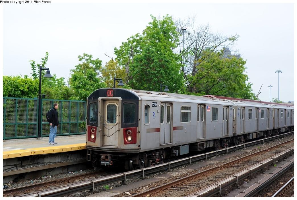 (302k, 1044x703)<br><b>Country:</b> United States<br><b>City:</b> New York<br><b>System:</b> New York City Transit<br><b>Line:</b> IRT Woodlawn Line<br><b>Location:</b> Bedford Park Boulevard <br><b>Route:</b> 4<br><b>Car:</b> R-142 (Option Order, Bombardier, 2002-2003)  1215 <br><b>Photo by:</b> Richard Panse<br><b>Date:</b> 5/22/2011<br><b>Viewed (this week/total):</b> 1 / 942