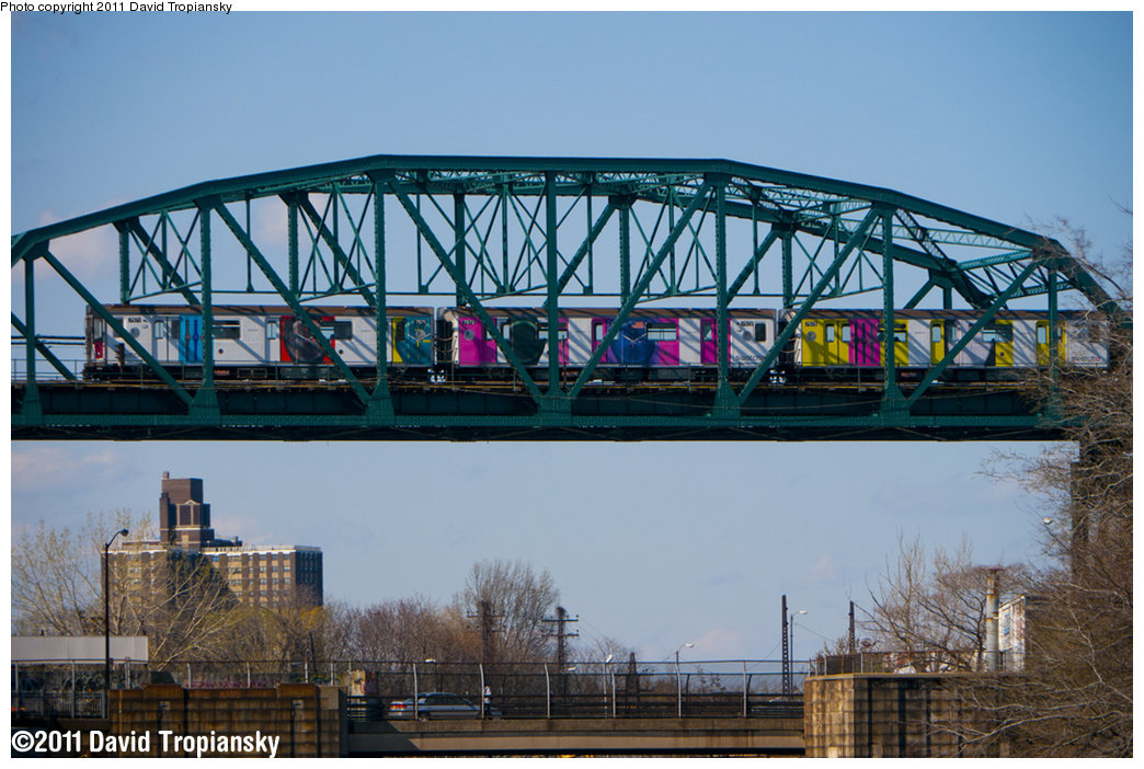 (402k, 1044x702)<br><b>Country:</b> United States<br><b>City:</b> New York<br><b>System:</b> New York City Transit<br><b>Line:</b> IRT Pelham Line<br><b>Location:</b> Bronx River Bridge <br><b>Route:</b> 6<br><b>Car:</b> R-142A (Primary Order, Kawasaki, 1999-2002)  7571 <br><b>Photo by:</b> David Tropiansky<br><b>Date:</b> 4/17/2011<br><b>Notes:</b> Note the Swatch ad wrap.<br><b>Viewed (this week/total):</b> 0 / 1521
