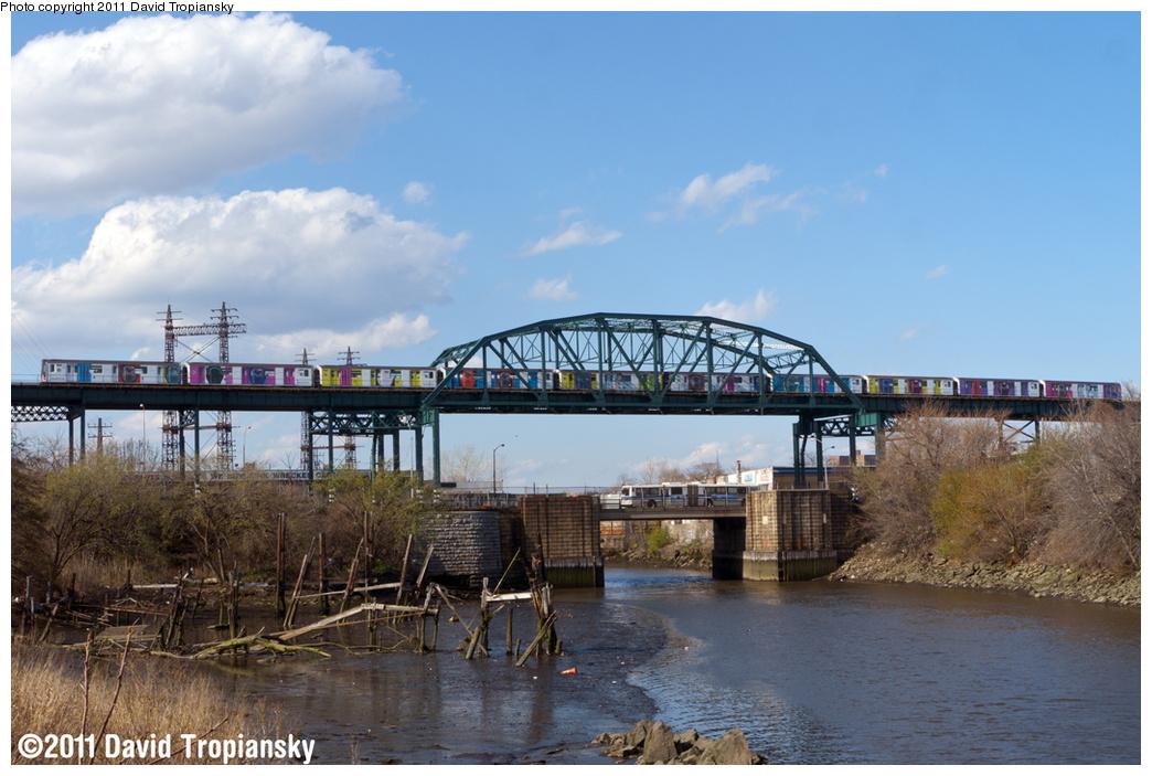 (341k, 1044x703)<br><b>Country:</b> United States<br><b>City:</b> New York<br><b>System:</b> New York City Transit<br><b>Line:</b> IRT Pelham Line<br><b>Location:</b> Bronx River Bridge <br><b>Route:</b> 6<br><b>Car:</b> R-142A (Primary Order, Kawasaki, 1999-2002)  7571 <br><b>Photo by:</b> David Tropiansky<br><b>Date:</b> 4/17/2011<br><b>Notes:</b> Note the Swatch ad wrap.<br><b>Viewed (this week/total):</b> 0 / 1268