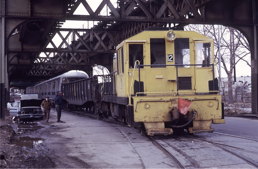 (224k, 1024x673)<br><b>Country:</b> United States<br><b>City:</b> New York<br><b>System:</b> New York City Transit<br><b>Location:</b> Coney Island Yard<br><b>Car:</b> GE 70T Locomotive (SBK)  12 <br><b>Photo by:</b> Doug Grotjahn<br><b>Collection of:</b> Joe Testagrose<br><b>Date:</b> 3/5/1972<br><b>Viewed (this week/total):</b> 1 / 1423