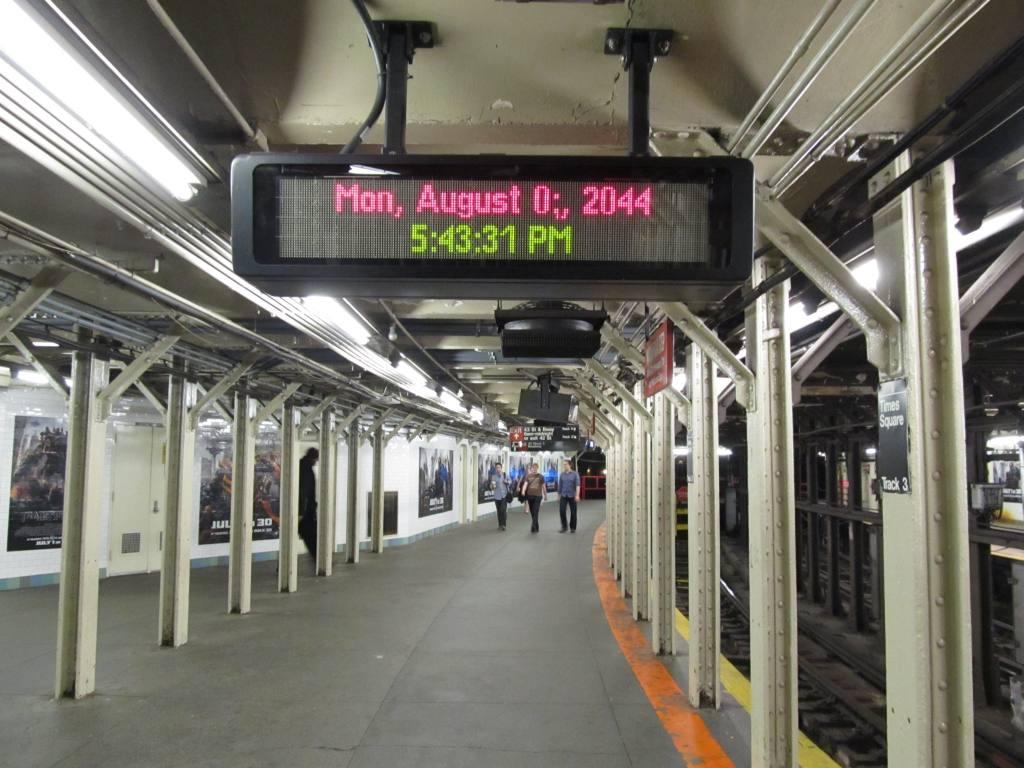 (120k, 1024x768)<br><b>Country:</b> United States<br><b>City:</b> New York<br><b>System:</b> New York City Transit<br><b>Line:</b> IRT Times Square-Grand Central Shuttle<br><b>Location:</b> Times Square <br><b>Photo by:</b> Robbie Rosenfeld<br><b>Date:</b> 6/13/2011<br><b>Notes:</b> Futuristic sign at Times Square shuttle track 3.<br><b>Viewed (this week/total):</b> 6 / 1885
