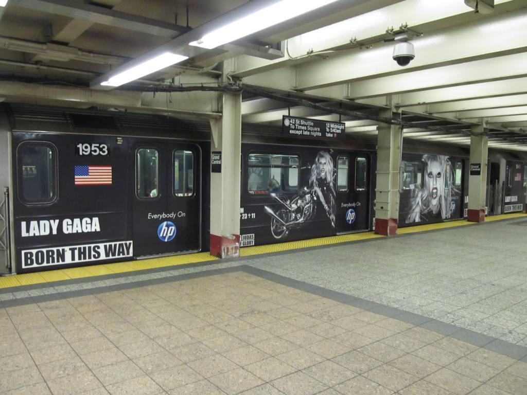 (112k, 1024x768)<br><b>Country:</b> United States<br><b>City:</b> New York<br><b>System:</b> New York City Transit<br><b>Line:</b> IRT Times Square-Grand Central Shuttle<br><b>Location:</b> Grand Central <br><b>Route:</b> S<br><b>Car:</b> R-62A (Bombardier, 1984-1987)  1953 <br><b>Photo by:</b> Robbie Rosenfeld<br><b>Date:</b> 6/13/2011<br><b>Notes:</b> Lady Gaga ad wrap.<br><b>Viewed (this week/total):</b> 0 / 1155